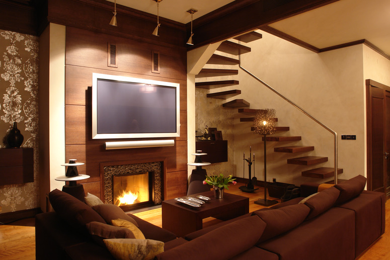 Interior Of A Living Room With Fireplace And Stairs